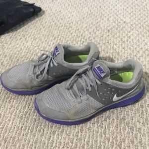 Grey and purple Nike running shoes